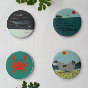 A set of sea themed pattern weights