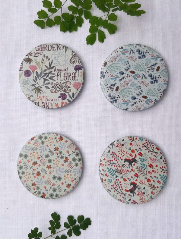 A set of pattern weights with a floral decoration by Meghan Radar set 1