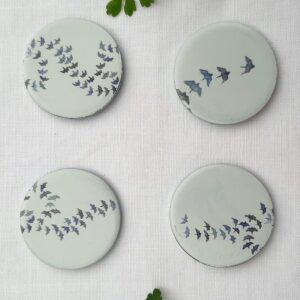 A set of pattern weights designed by Valeriane Leblond with small blue birds