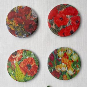 A set of pattern weights designed by Jan Ford with poppies and Roses set 2