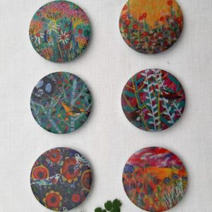 A set of pattern weights designed by Claire West of vibrant scenes of nature