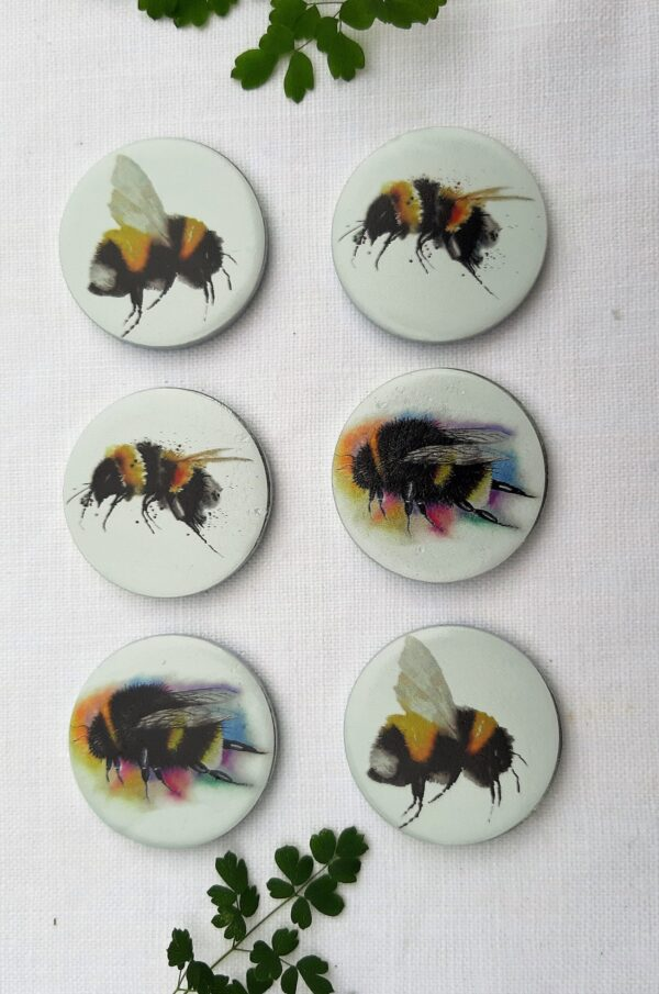 A set of 6 pattern weights designed by Maria Moss with a bee design