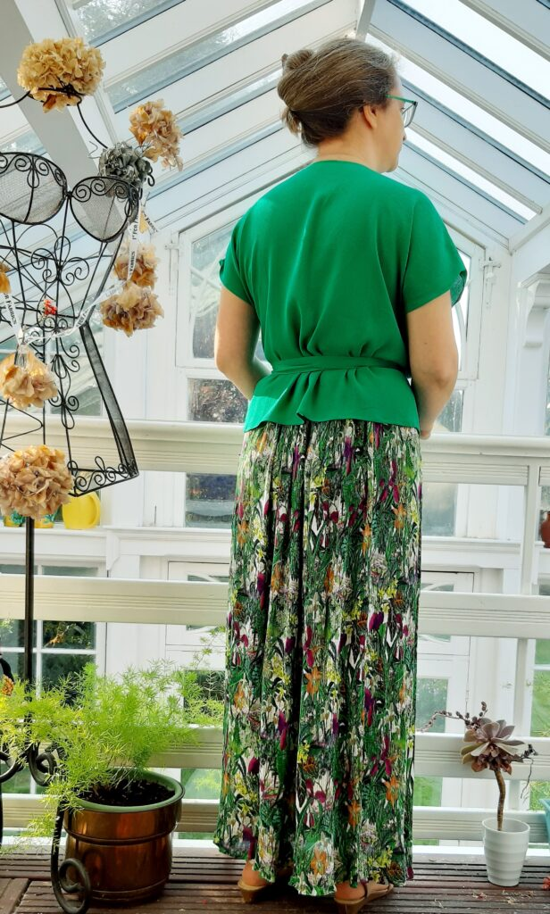 A back view of Pippa wearing a zadie wrap top and maxi skirt